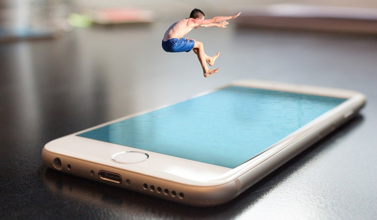Someone jumping in a pool made of a smartphone